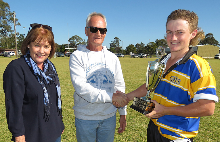 Stephen and Jenny Hoare present the Chris Hoare Cup to Gloucester Team Captain.