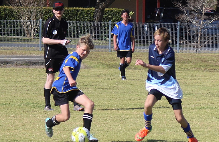 Boys Soccer: BCS team member Dane Pope challenges a Gloucester player.