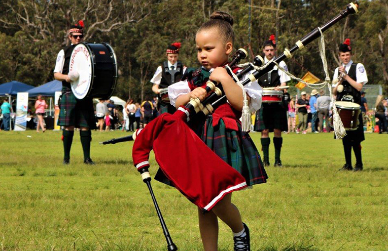 The Littlest Piper Youland Gibbs with the pipers and drummers at the 2017 Festival. Images supplied by Clans on the Coast.