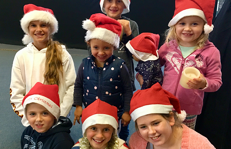 Children of the Howarth & Rapley families;  Sophie, Tom, Madeleine, Alice, Poppy, Laura and Saxon, all very excited about The Myall Coast Christmas Carols.