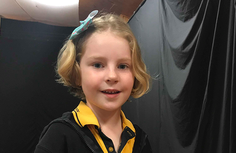 Scarlett with her new 'do, raising more than $1,100 for Variety.