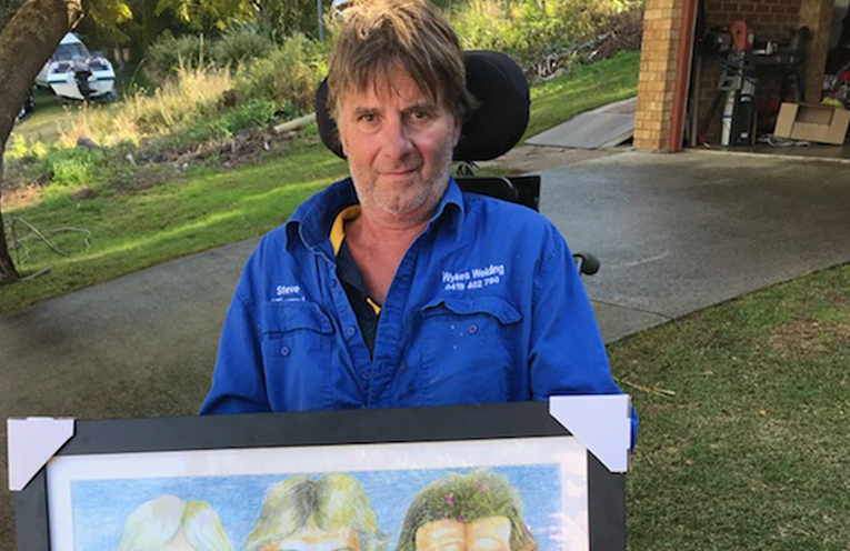 Steven Lingard with the Eels greats artwork that is included in the raffle to raise funds to support Steven and his family.