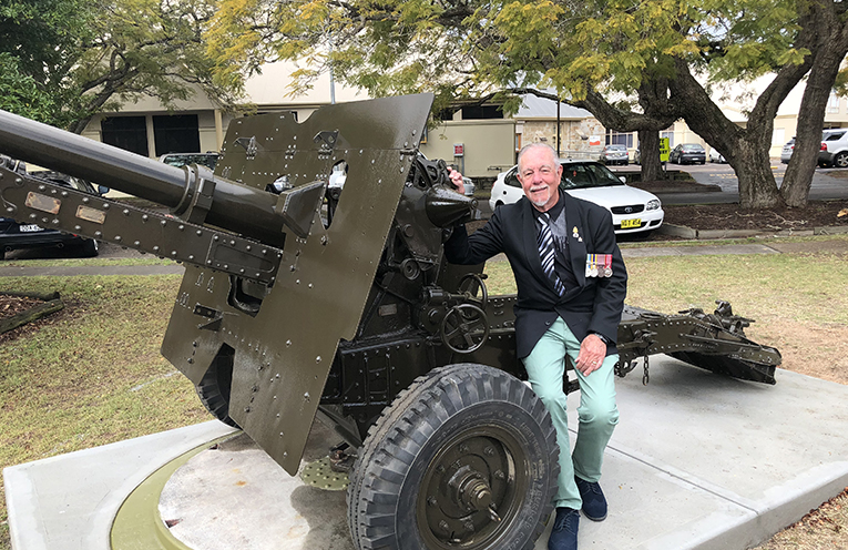Kerry Allen, whose father served in New Guinea, using artillery like this piece.