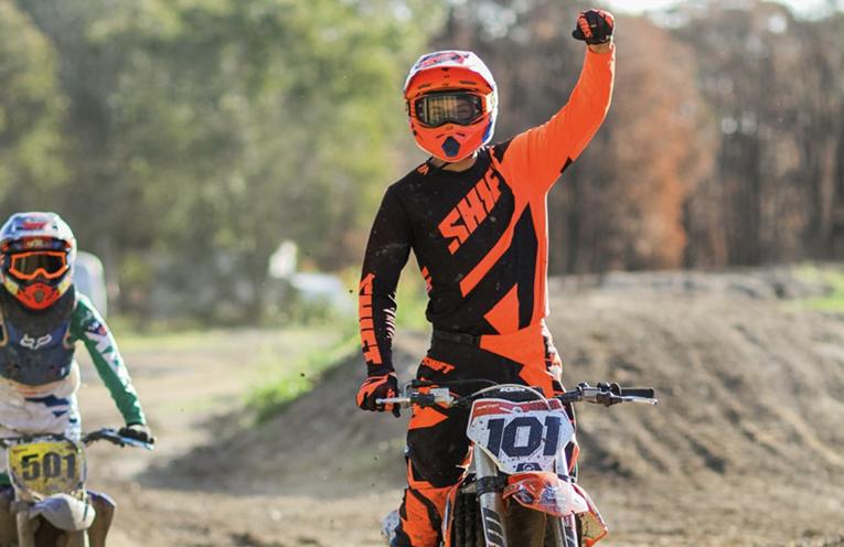 Luke (number 101) training dirt bike riders at his private Salt Ash track.