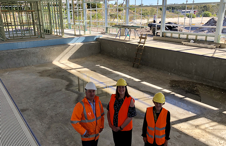 Ben Jenkinson from Nelson Bay Swimming and Wellness Academy with Port Stephens Liberal Candidate Jaimie Abbott and Port Stephens Duty MLC Catherine Cusack in the pool construction zone at the Taylors Beach Swimming Centre.