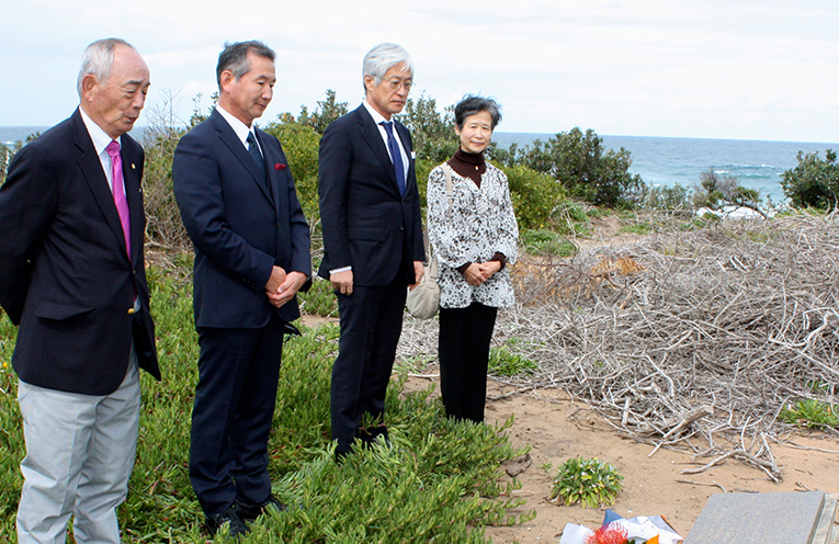 Delegation of  Yoshinori Hayatoh, President of the Yugawara International Exchange Association; Seiichi Tsuchiya, Town Councillor; and Tadashi Takahashi, Superintendent of the Yugawara Board of Education. paying respect at the grave of the Sister Cities Founder John Bartlett in Port Stephens.