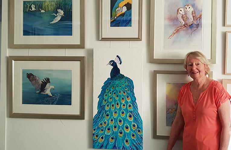 Nada O'Loughlin-Yonge with some of her artworks on display at the Port Stephens Community Arts Centre.