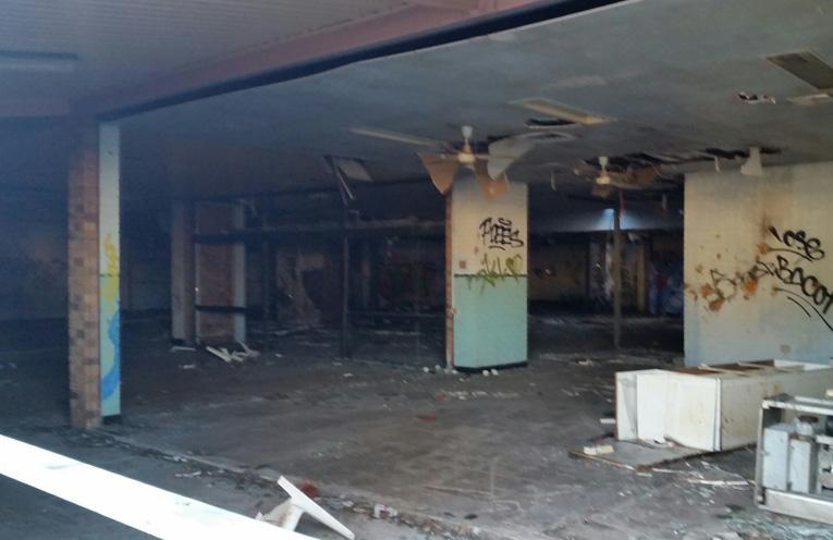Inside one of the rundown empty shop fronts.