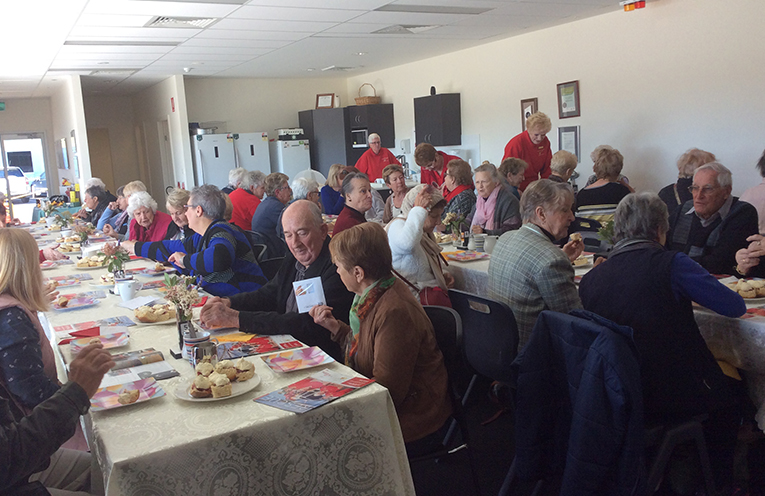 Enjoying a cuppa and scones with the Westpac Helicopter Broadmeadow Base Volunteers.