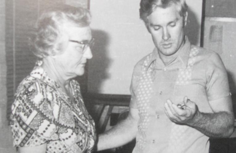 Eunice Brooks receives her life membership badge from Salt Ash life member Bruce MacKenzie.