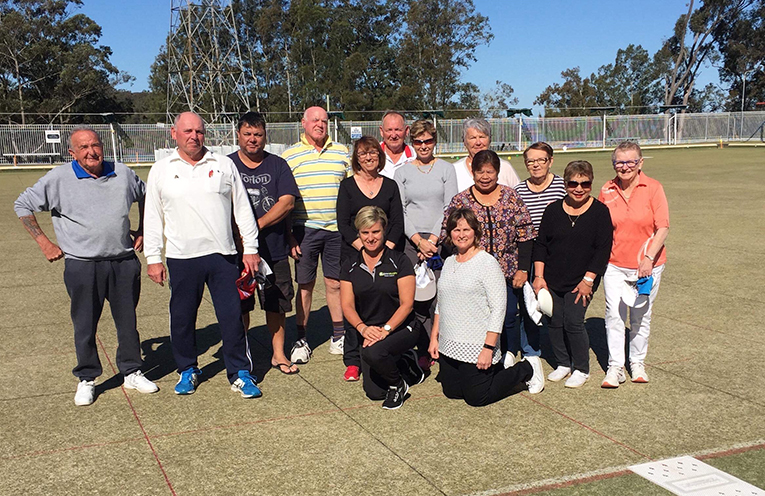 Karen Murphy (centre on 1 knee) and a selection of the Karuah bowlers improving their game.