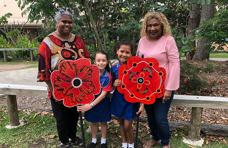 Indigenous Wirreanda students Lola and Klyce, who participated in the making of the poppies, with grandparents who assisted with the project, Aboriginal grandmother Jocelyn Archer and Torres Strait Islander Grandmother Del Shipway.