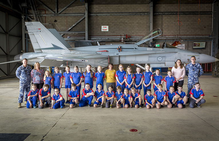 Wirreanda Public School students and staff with RAAF personnel and an F/A -18 Hornet.