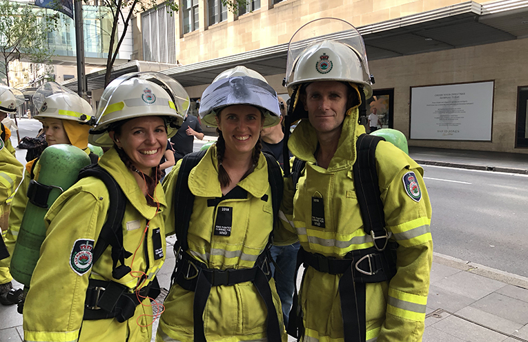 Medowie Rural Fire Brigade members Alice, Kyra and Darryl, kitted up and ready for the climb.