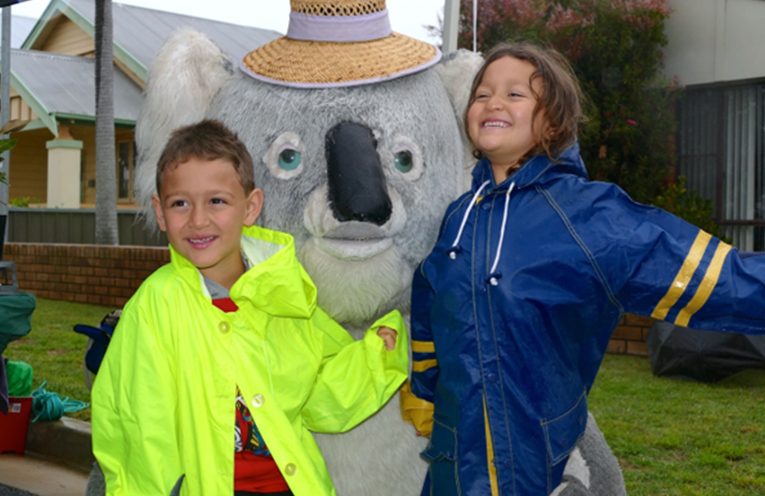 Young visitors Omar and Aya from Hornsby enjoy a cuddle with Kim the Koala.