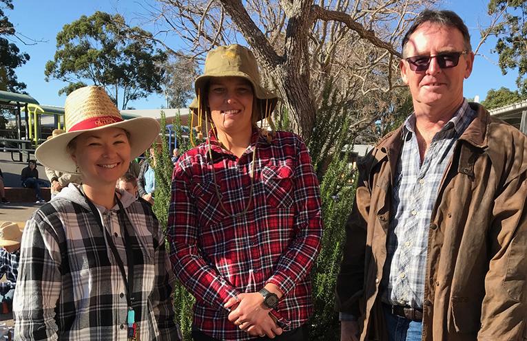 Sarah Bailey, Kate Handley and Mick Groth on one of the 'dress like a farmer' days.
