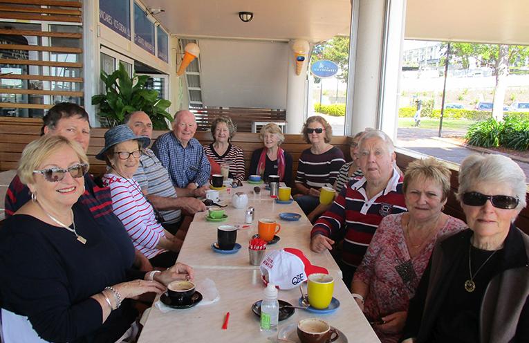 Fingal Bay Probus Club Walking Group enjoying coffee after a walk along the Nelson Bay Breakwall.  Photo by Lynn Moffitt.