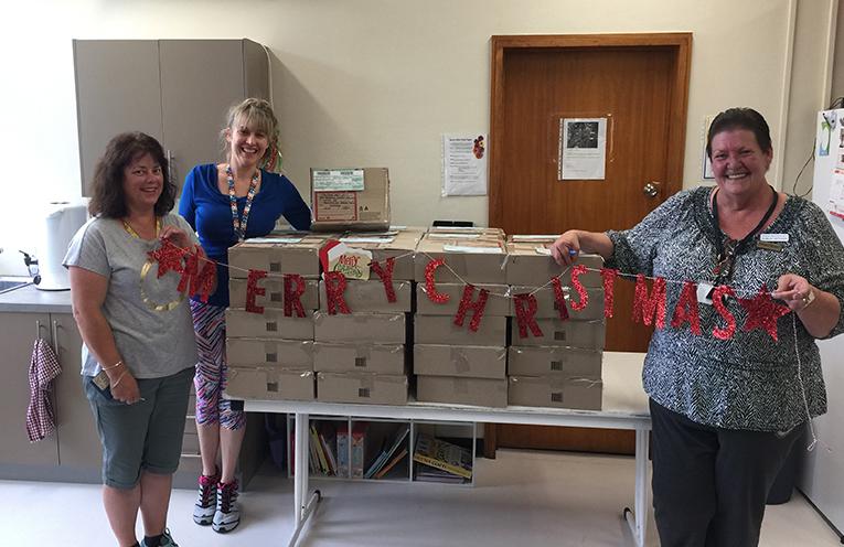 Krystal Rowell, WDFG President with volunteers Helen Lind and Diane Ryan, packing boxes.