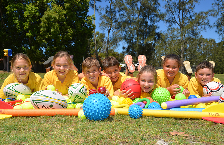 TEA GARDENS PRIMARY SCHOOL STUDENTS: Loving the equipment donated through the Coles Sporting Program.
