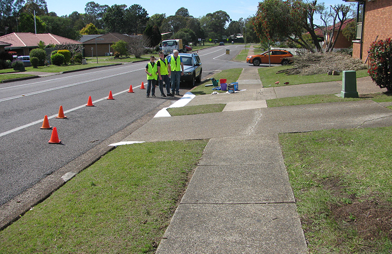 A completed set of kerb wings for a home in Benjamin Lee Drive in Raymond Terrace, painted by the Scouts.