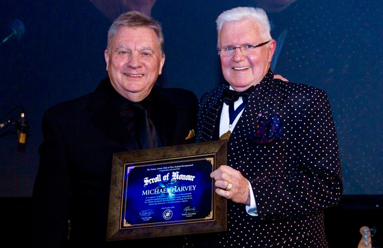 Michael Harvey (LEFT) receiving the Variety Artists Club (VAC) Scroll of Honour, with VAC Patron, David Hartnell MNZM.
