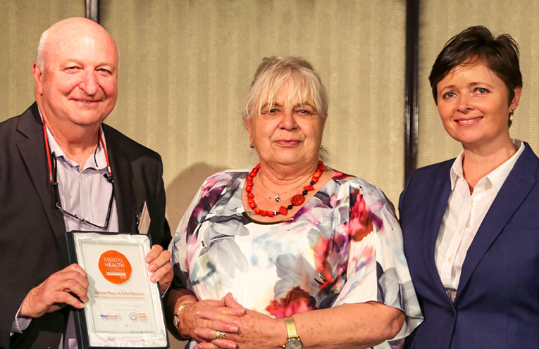 Port Stephens Suicide Prevention Network members receiving the award from WayAhead.