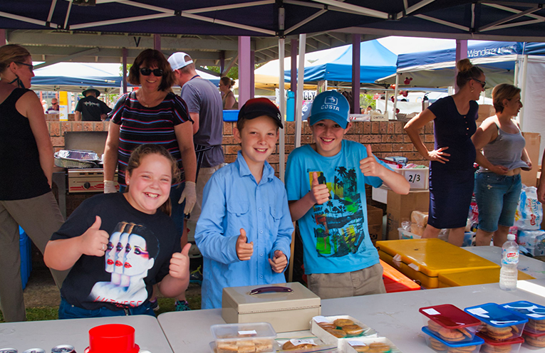 Jorja, Edward and Tom helping out at the cake stall for Karuah Public School.  Photo by Jack DRAKE