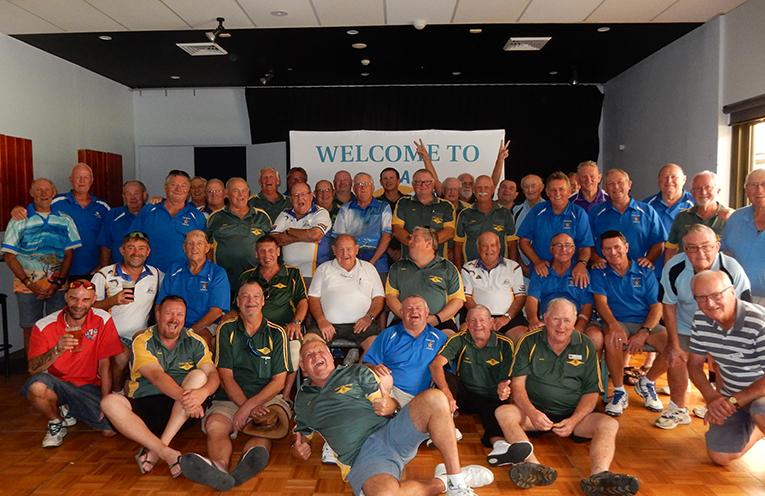 Teams from Tea Gardens, Fingal Bay and Kotara celebrating the game of bowls.