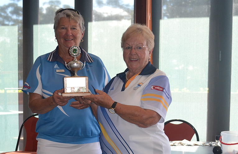 Club President of Karuah Women's Bowling Club, Helen Priest  presenting the Ruth Bowden Trophy to TGWBC Vice President Pam Gilchrist.