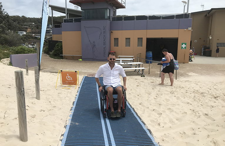 Shane Heyhorec taking his wheelchair for a spin on the matting which makes it easy to get to the water's edge. Photo by Marian Sampson.