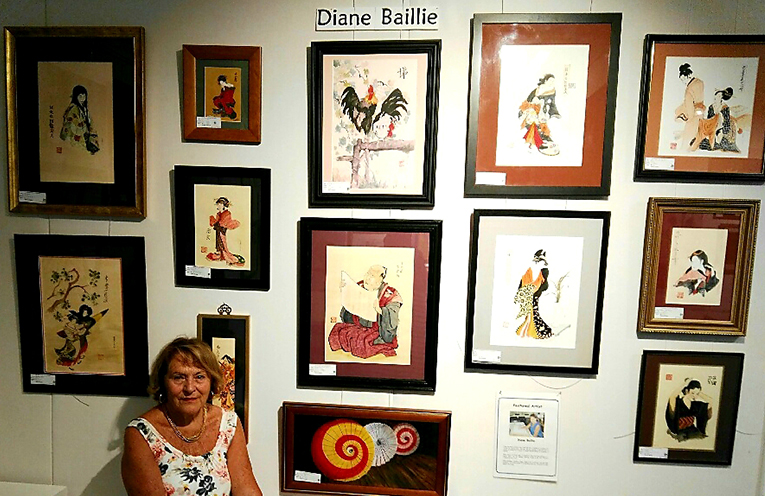 Diane Baillie with some of the Oriental inspired artworks.