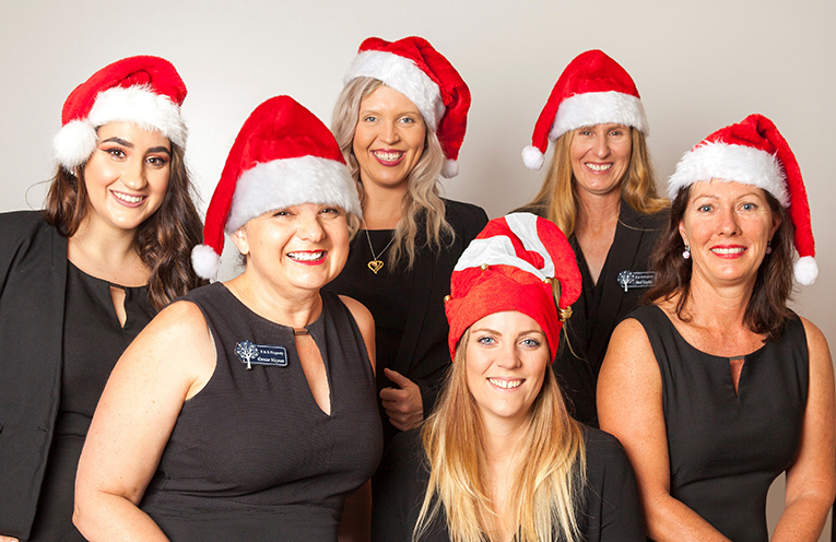 Some of the R&R Property team members getting into the Christmas spirit, ready for the Medowie Christmas Festival.