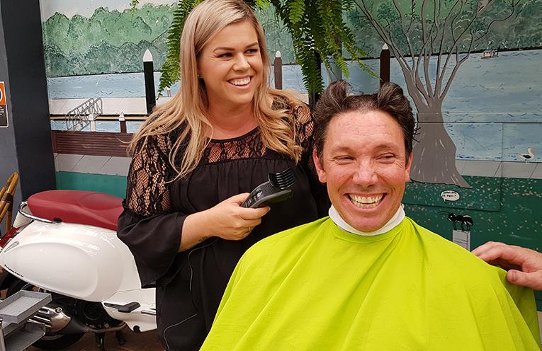 'BIG SHAVE': Tea Gardens Publican Ben Hanson with Hairdresser Katherine Robertson.