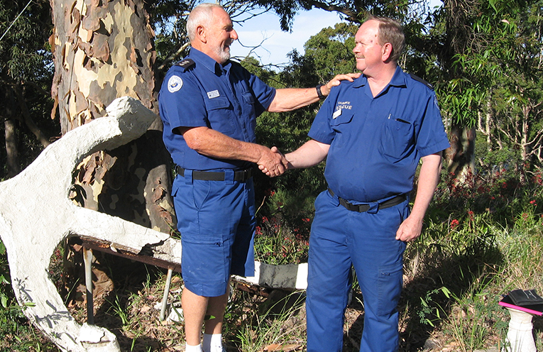 Commander Richard Tyler (left) congratulating Richard Osborne on his 35 Years of Service, four of which were as Commander.