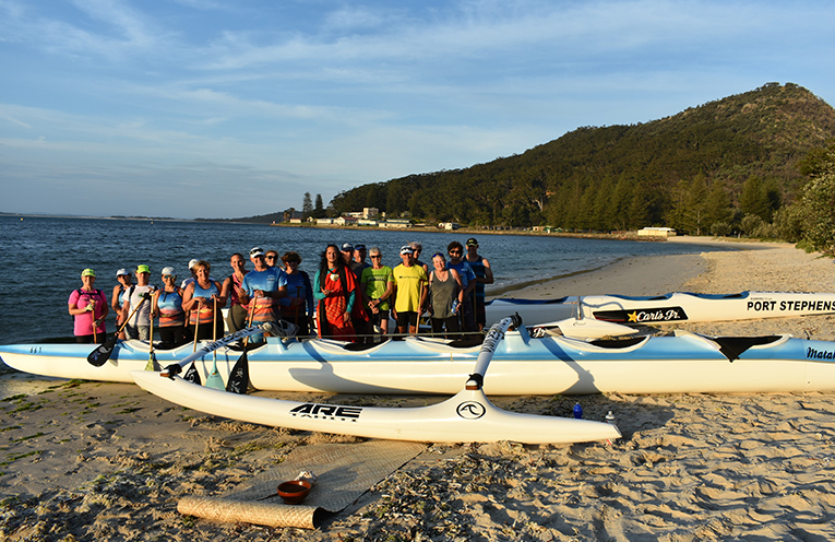 The Port Stephens Outrigger Canoe Club gather for the blessing