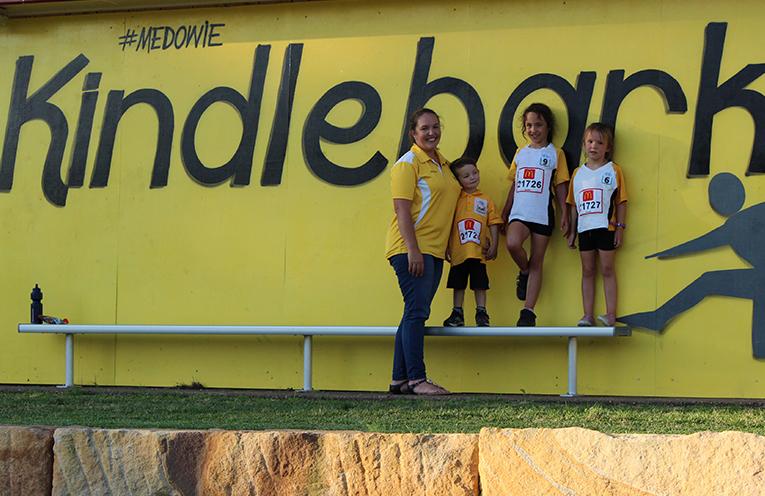 Marnie Coates, Secretary of Medowie Little Athletics, with Marcus, Tori and Ryah