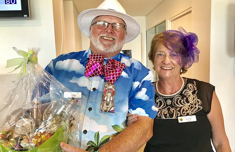 Probus members and best tie winner David Long with Debbie Long.