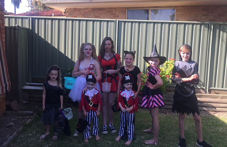 Children dressed up for trick or treating.