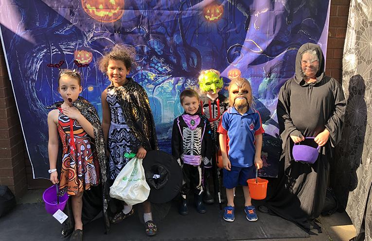 Medowie children at the house of the 'Medowie Swamp Hag' on Grey Gum Street.