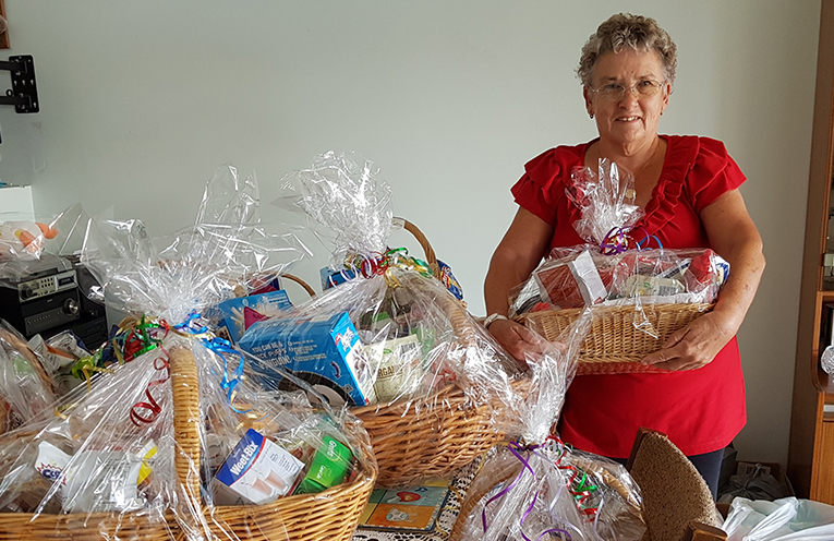 COMMUNITY CHRISTMAS LUNCH: Sue Douglas with some of her donated hampers.