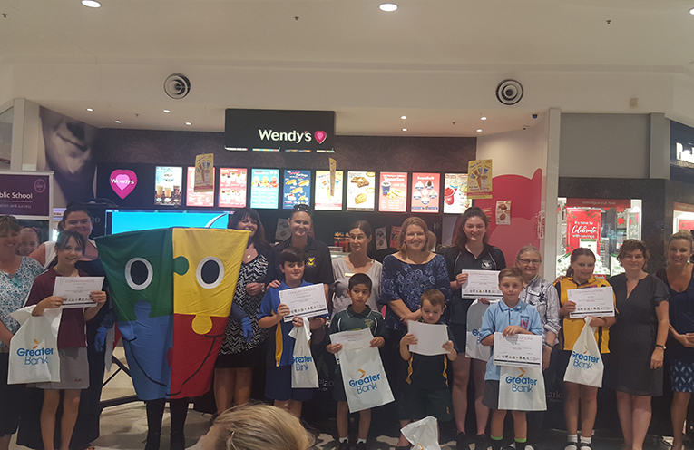 This week's PBL winners, with their school representatives.