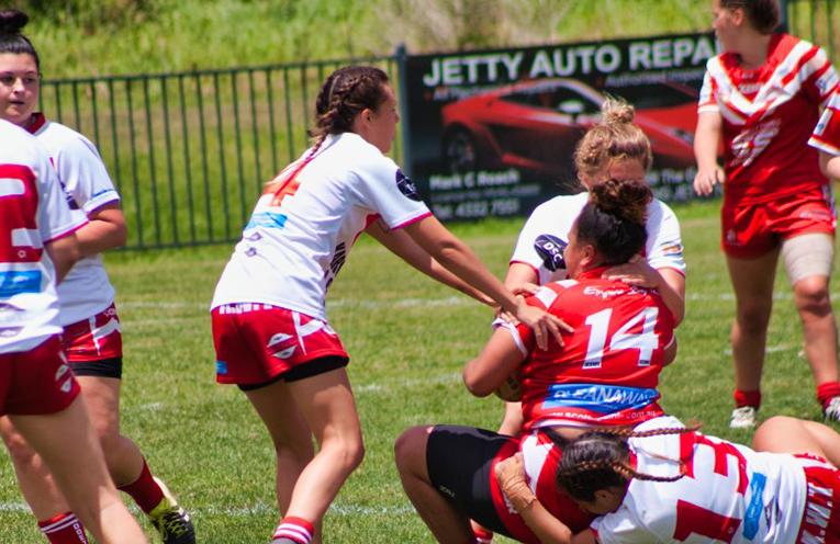 Ashley Bills, Chantelle Gallagher and Ebony Oakley tackling hard. Photo by Jack Drake