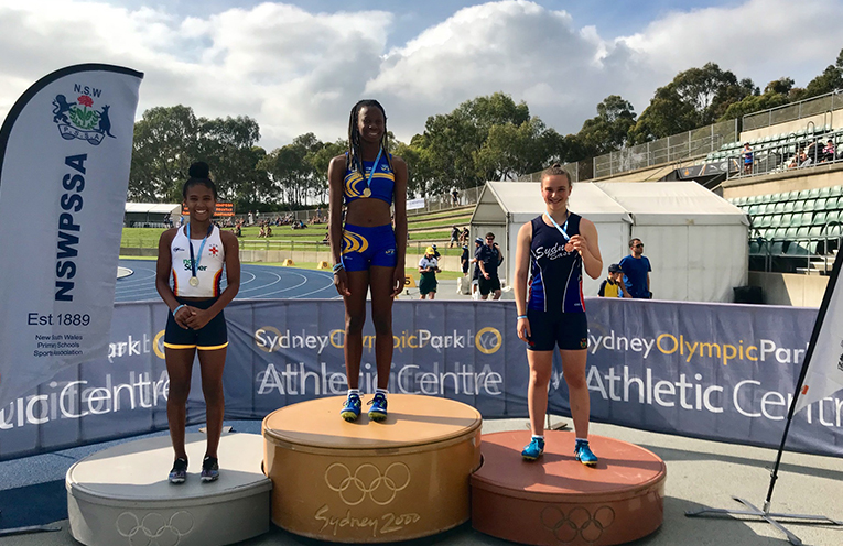Shari on the podium with her gold medal for the 200 metre sprint.