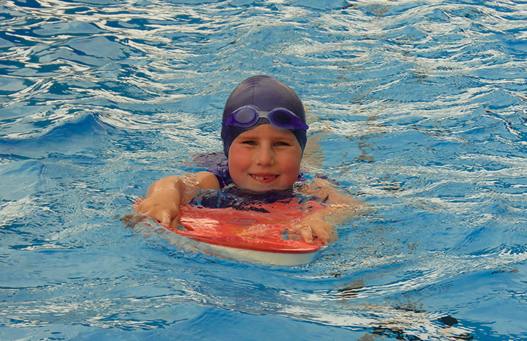 Evie Kemp enjoyed the kickboard race for fun during the first meet.