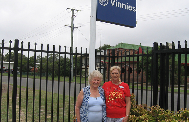 Volunteers Jane Dorney and Gaye Smith beside Vinnies' new security fence.