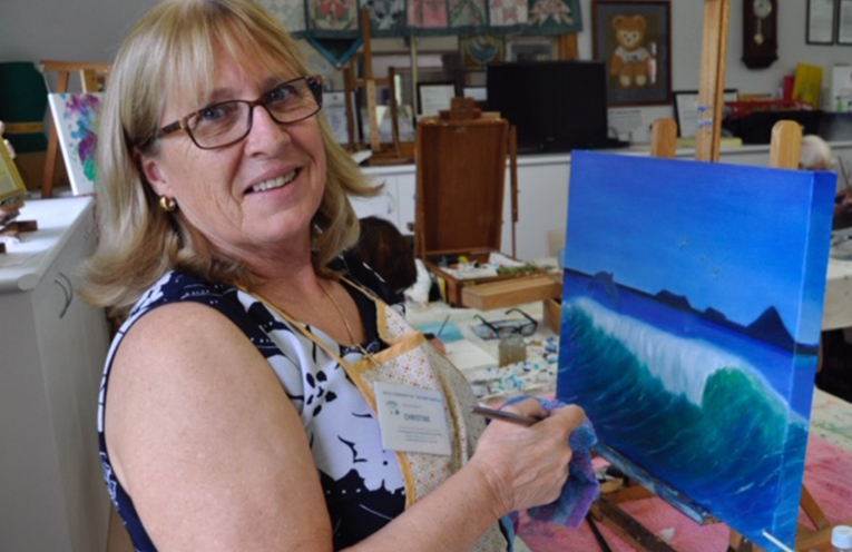MYALL CENTRE ARTIST: Christine Baker working on a seascape in acrylic.