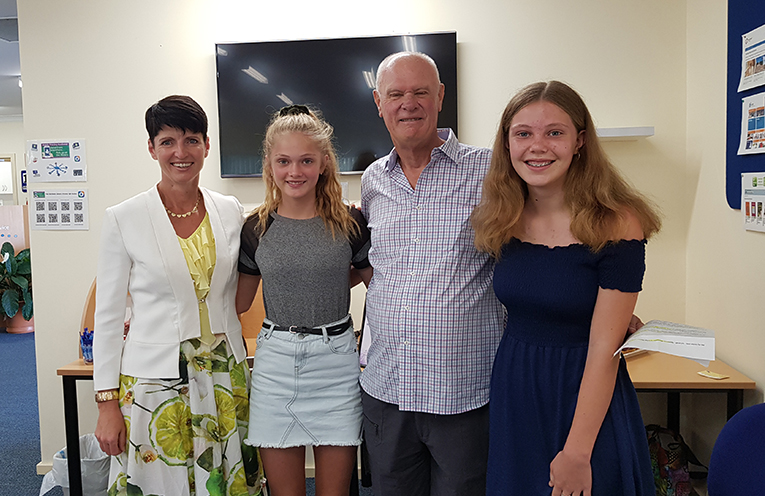 GRANDPARENT OF THE YEAR: Ms Kate Washington, Ron Sunderland (centre) with granddaughters Sari and Eve.