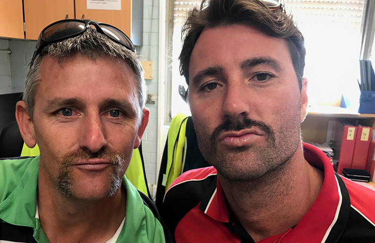 Mr Hurley and Mr Hughes showing off their contribution to Movember.