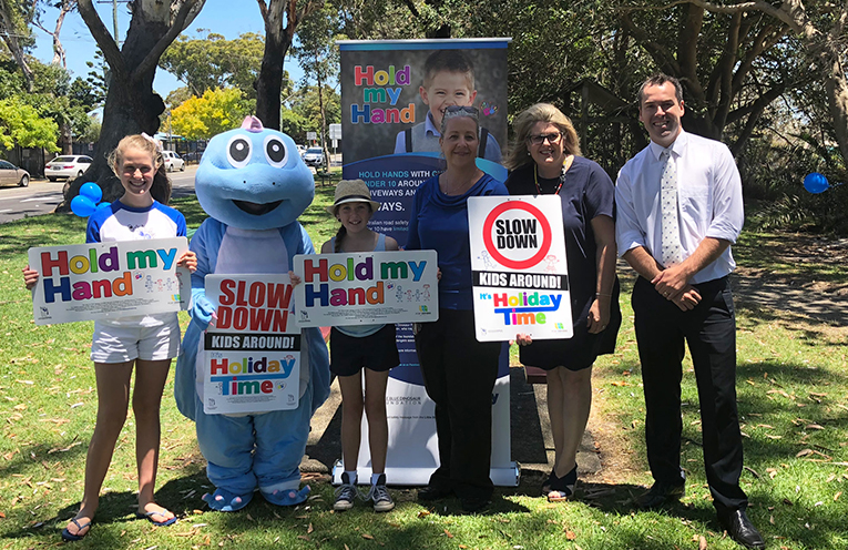 Council's Road Safety and Traffic Officer Lisa Lovegrove (middle), Little Blue Dinosaur founder Michelle McLaughlin (right) and Mayor Ryan Palmer (far right).