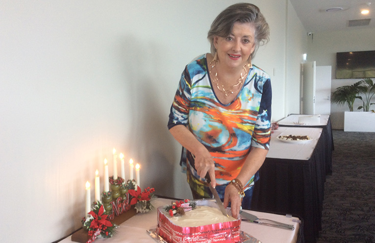 Betty Holbrook cutting her yummy Christmas cake for Tomaree Ladies and friends at their final year's luncheon at Nelson Bay Golf Club.